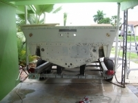 1990 Mako back transom loaded with holes from brackets and more. Before pic