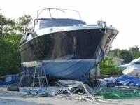 Finished picture of 62 techno with bottom paint, black metallic hull and white topside.
