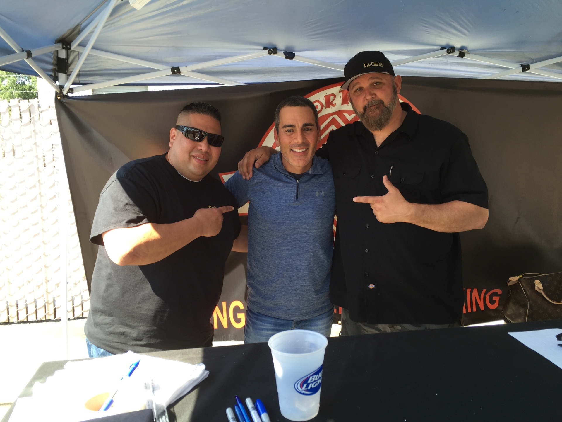 Paul Lo Duca with the owners of Papi Chulo's Sports Bar