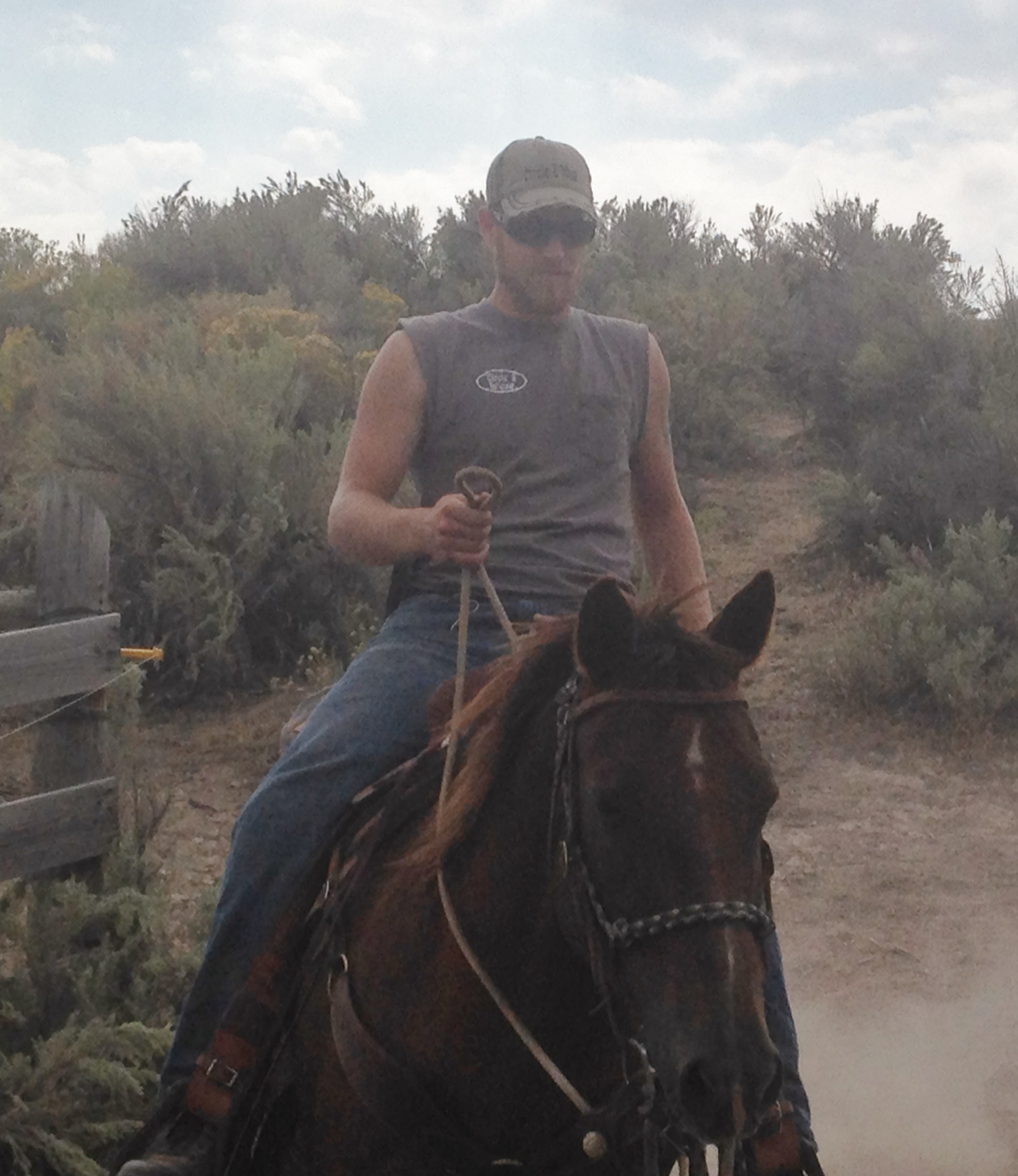 Partner Garret Ward Horseback ride home after long day pushing cows to be worked