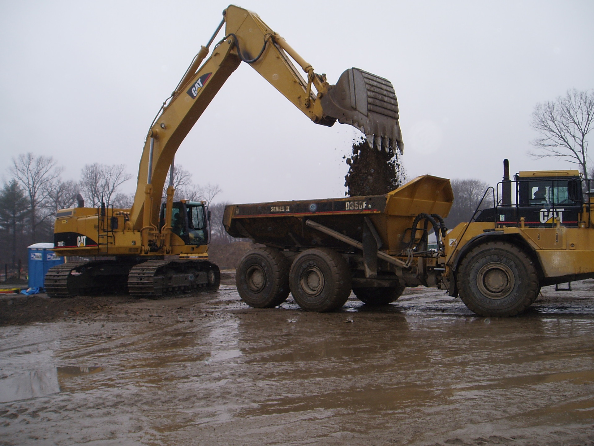 Cat 365 and D350 Excavating for L.L. Bean Mansfield MA