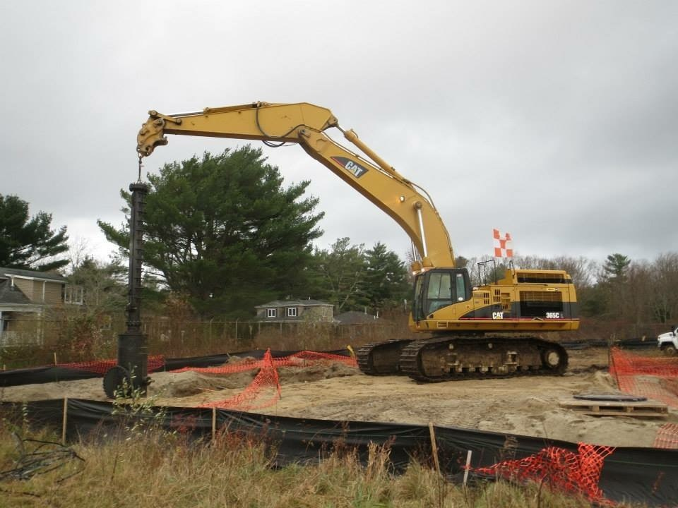 """Cat 365 Holding a 36"""" Iine Stop at the New Bedford Airport."""