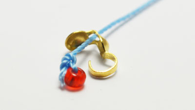 Fix down the seed bead with a secure knot