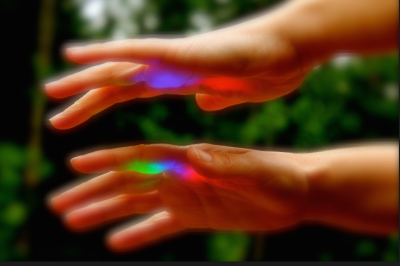 Light shining on Kym's hands at Shanti Living Wellness