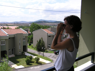 My friend Jana gazes out over the Koç housing complex to the hills of Istanbul. Turkey: annmariemershon.com