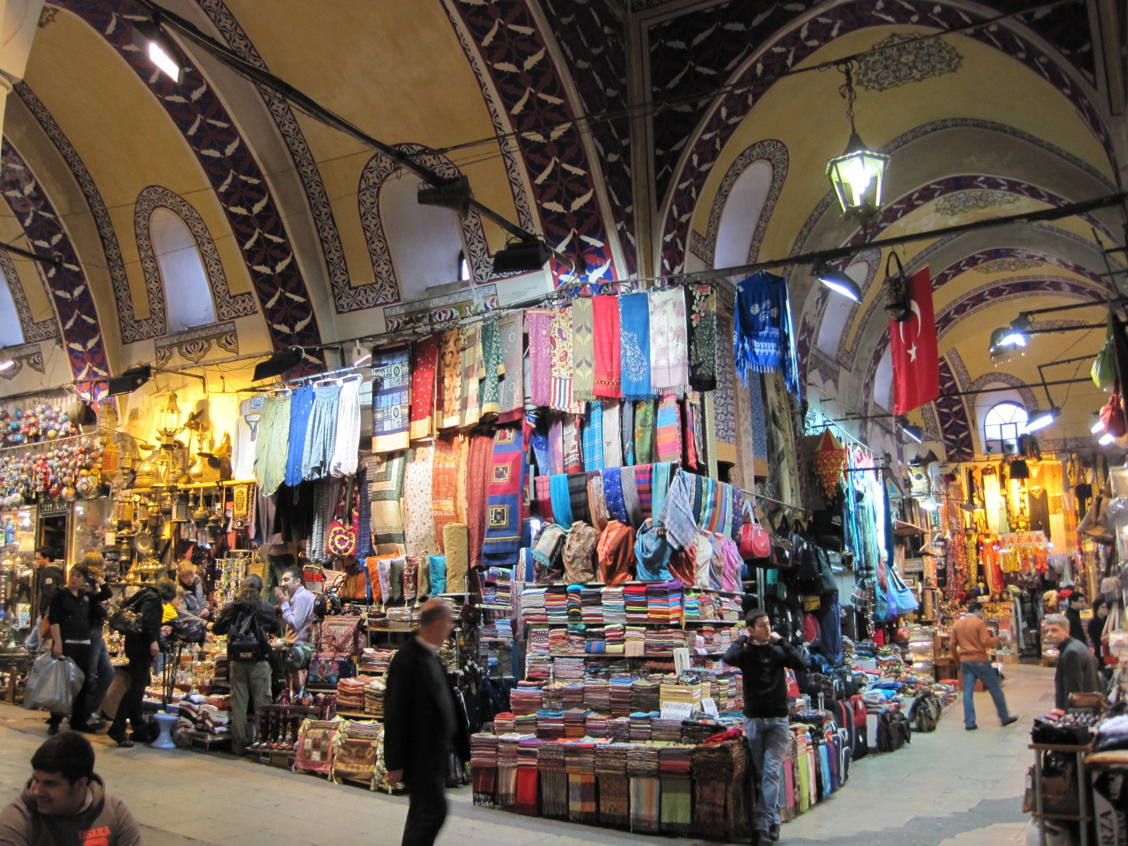 Textiles are displayed ceiling high in the Grand Bazaar. Istanbul, Turkey: annmariemershon.com