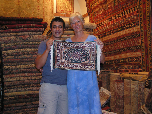 Selçuk and Ann Marie display his thousand-dollar silk carpet. Istanbul, Turkey: annmariemershon.com