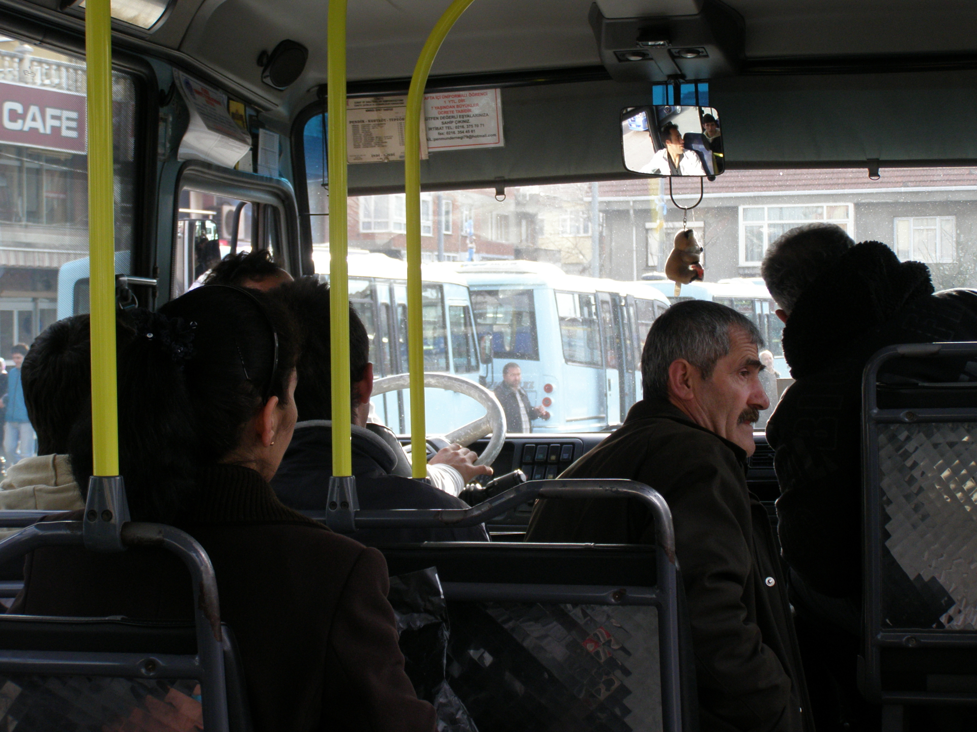 An inside view of a city mini-bus, with others lined up alongside. Istanbul, Turkey: annmariemershon.com