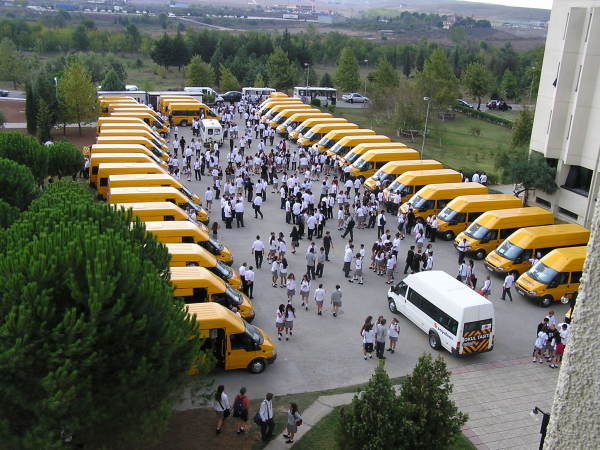 A bevy of mini-busses transport Koç students across Istanbul. Turkey: annmariemershon.com