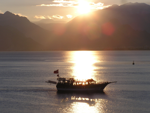 An Antalya cruising vessel returns to port at sunset. Turkey: annmariemershon.com