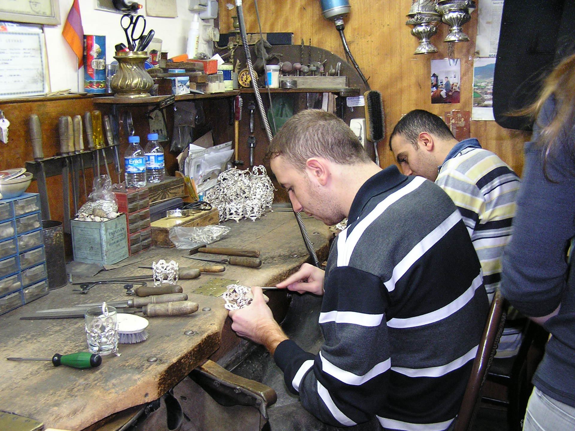 Silversmiths file silver cup holders  in the workshop of Aruş Taş, Kalcılar Han. Istanbul, Turkey: annmariemershon.com