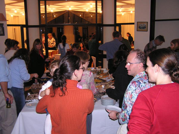 Teachers line up, eager for the Thanksgiving feast. Istanbul, Turkey: annmariemershon.com