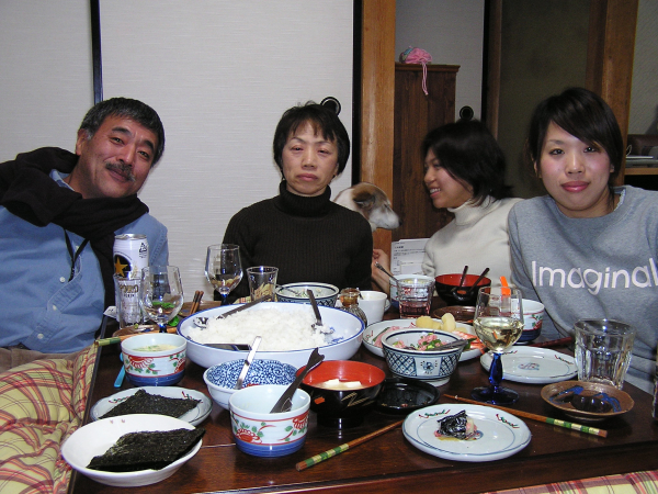 The Suzuki family poses over one of many fabulous meals. Japan: annmariemershon.com