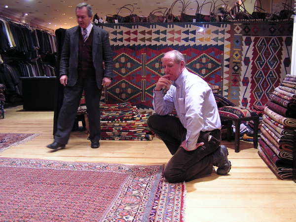 My friend Phil considers a major carpet purchase. Istanbul, Turkey: annmariemershon.com
