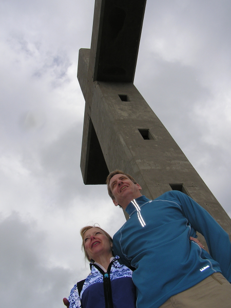 Annie and Mike pose under the huge concrete cross.Rhodes, Greece: chapter 33, You must only to love them. http://mershon.wordpress.com