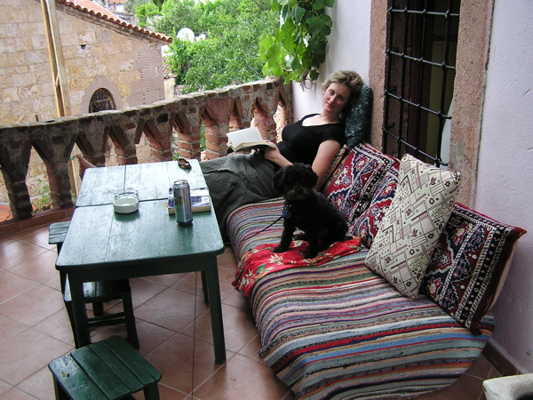 My friend Nora relaxes with Libby on the terrace of our Ayvalık pension. Ayvalık, Turkey: chapter 35, You must only to love them. http://mershon.wordpress.com