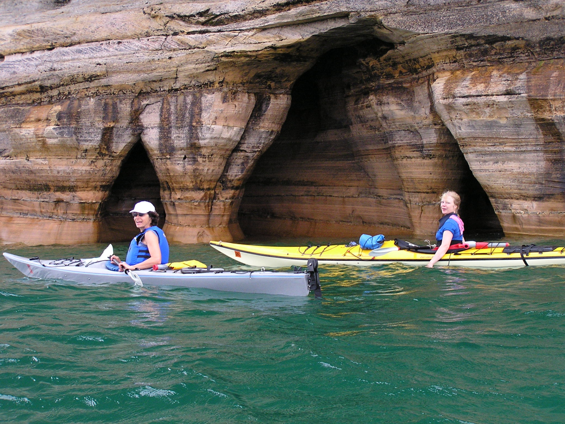 Jini and Annie pause after poking into shoreline caves.Pictured Rocks National Lakeshore, Michigan: chapter 38, You must only to love them. http://mershon.wordpress.com