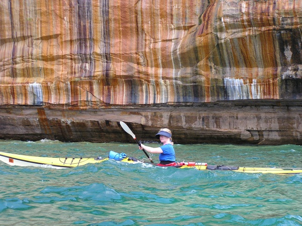 Annie paddles by the multi-colored cliffs that gave this park its name.Pictured Rocks National Lakeshore, Michigan: chapter 38, You must only to love them. http://mershon.wordpress.com