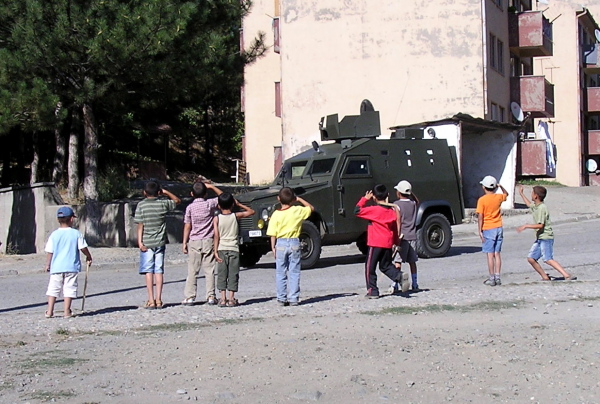 When soldiers drove by, these Turkish boys leapt to attention. Kemaliye & Divriği, Turkey: chapter 41, You must only to love them. http://mershon.wordpress.com