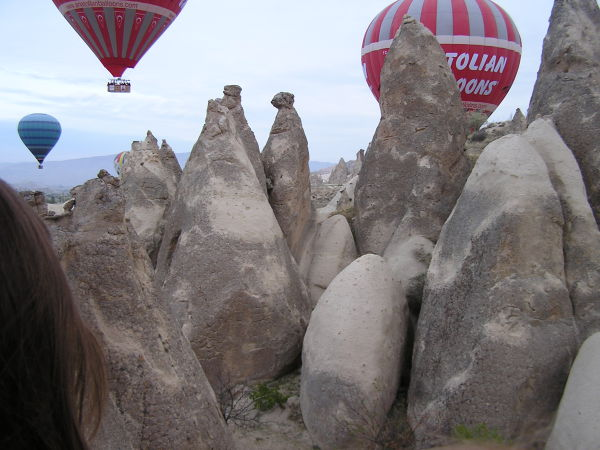 Early morning balloons float through Cappadocia's eerie landscape. Cappadocia, Turkey, chap 44, You must only to love them. http://mershon.wordpress.com
