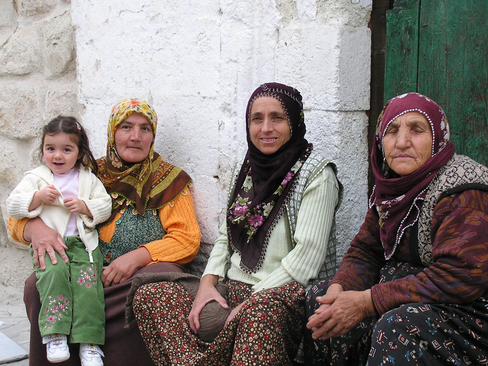 These ladies, in typical dress, chat on a doorstep in Göreme. Cappadocia, Turkey, chap 44, You must only to love them. http://mershon.wordpress.com