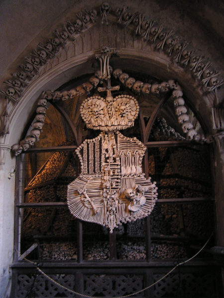 The Bone Church features a crest and crown crafted of bones.  Prague, Czech Republic: chapter 49, You must only to love them. http://mershon.wordpress.com
