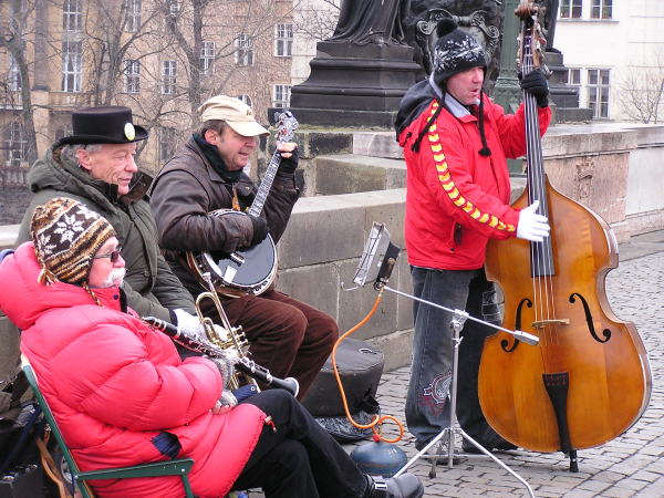 Musicians play on St. Charles Bridge in spite of the cold. Prague, Czech Republic: chapter 49, You must only to love them. http://mershon.wordpress.com