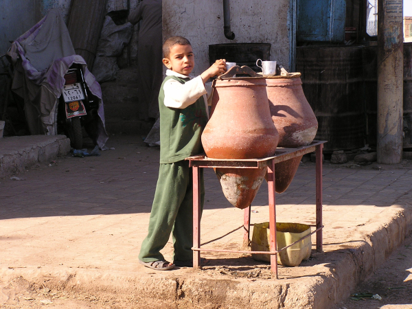 An Egyptian boy helps himself at a community water supply. Nile River Valley, Egypt: chapter 50, You must only to love them. http://mershon.wordpress.com