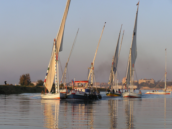 A bevy of Nile Feluccas surround a small river craft. Nile River Valley, Egypt: chapter 50, You must only to love them. http://mershon.wordpress.com