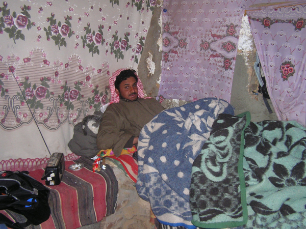 This chilly shopkeeper snuggled under numerous blankets  as he awaited customers.Mount Sinai, Egypt: chapter 51, You must only to love them. http://mershon.wordpress.com