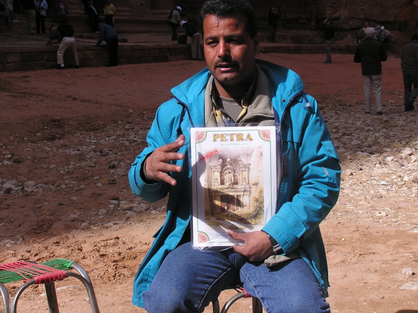 Our amazing guide Mahmud wore my blue jacket as he explained the history of his previous home. Petra, Jordan: chapter 52, You must only to love them. http://mershon.wordpress.com