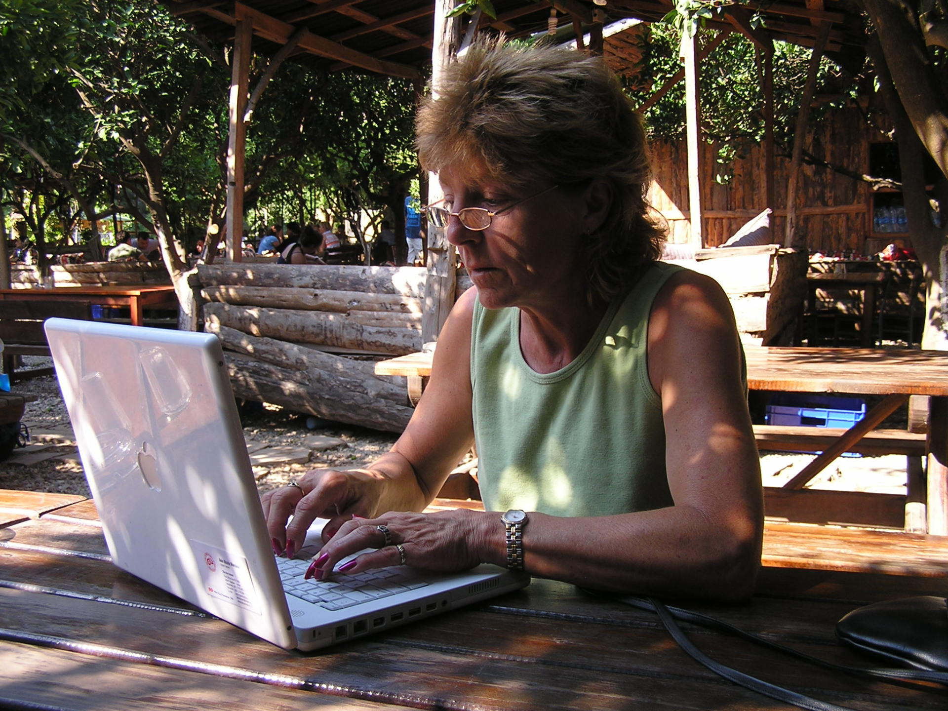 Susie checked her e-mail in the open courtyard at Bayram's. Olympos, Turkey: chapter 60, You must only to love them. http://mershon.wordpress.com
