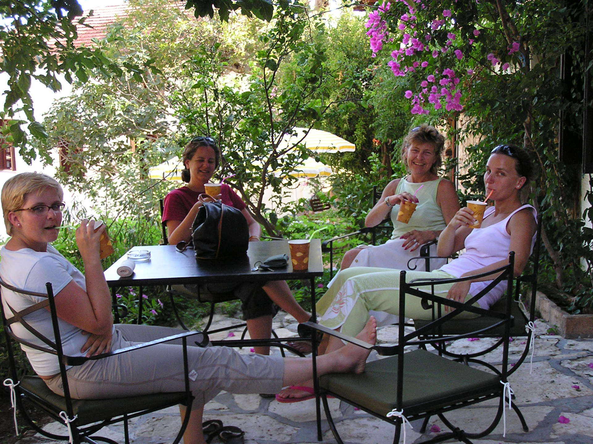 Bea, Shelly, Susie and Jana sip lattes outside the charming Balikçi Han. Kalkan, Turkey: chapter 60, You must only to love them. http://mershon.wordpress.com