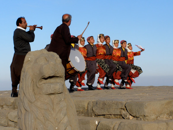 A group of school children braved frigid winds to perform  traditional dances on Mount Nemrut. Nemrut, Turkey: chapter 69, You must only to love them. http://mershon.wordpress.com