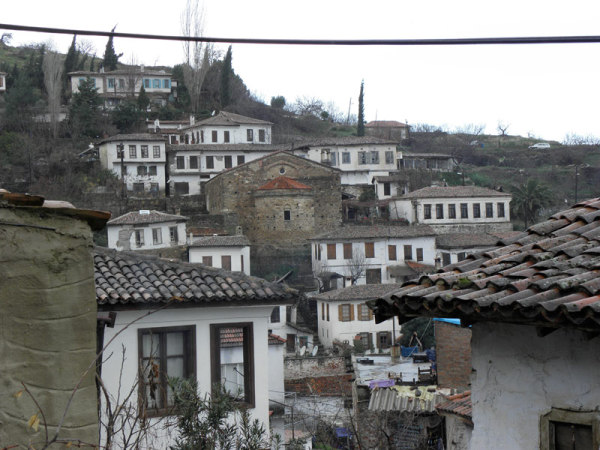 In Şirince, centuries-old white homes climb the hill, surrounding a once-active Christian churc. Şirince, Turkey: chapter 75, You must only to love them. http://mershon.wordpress.com