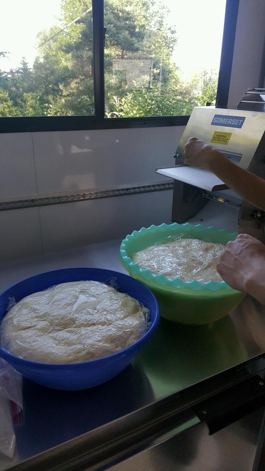 The dough rising.