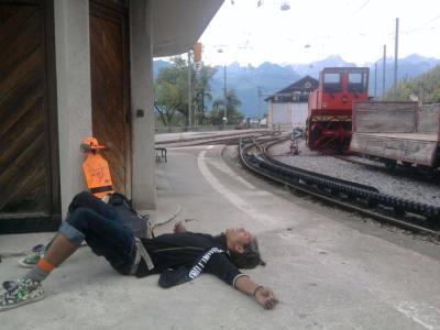 Lying on floor, train station, outside