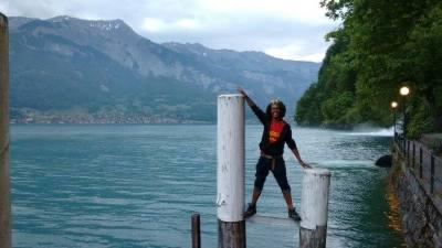 Standing on poles, lake geneva behind