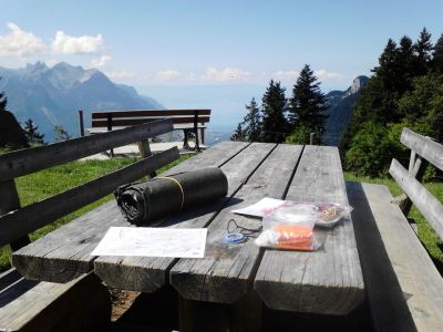 Equipment on outdoor table, mountains backdrop