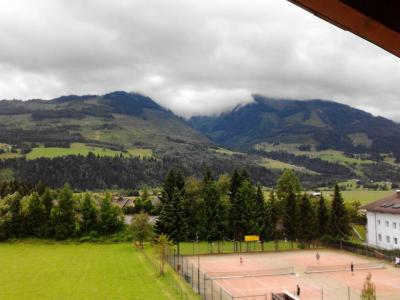 View of tennis courts, with mountains behind