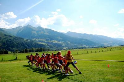 Tug of war, against a backdrop of mountains