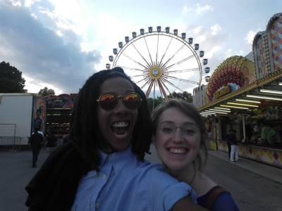 Friends in front of a Ferris wheel