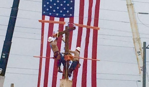lineman rodeo team with flag back ground