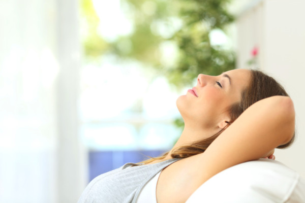 relaxed woman breathing clean, fresh indoor air