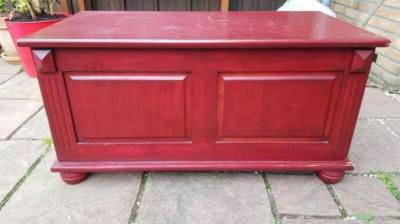 Antique wooden chest in red