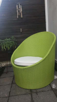 Green rattan lounge chair