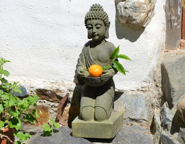 Buddha offering an orange