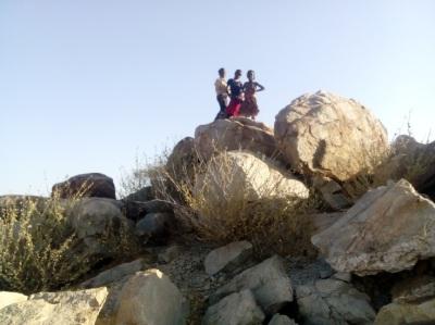 Children posing on the rocks