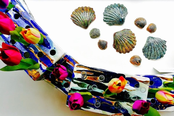 British Ceramic art tulip vases delt harbour wall Clay West Coast Saundersfoot Pembrokeshire Ceramic Art Richard Prentice Blackbird Ceramics Naomi Tydeman Coast Restaurant Penally Abbey St Brides Spa Hotel The Grove Narberth Welsh Wales Ceramic Art Studio Pottery