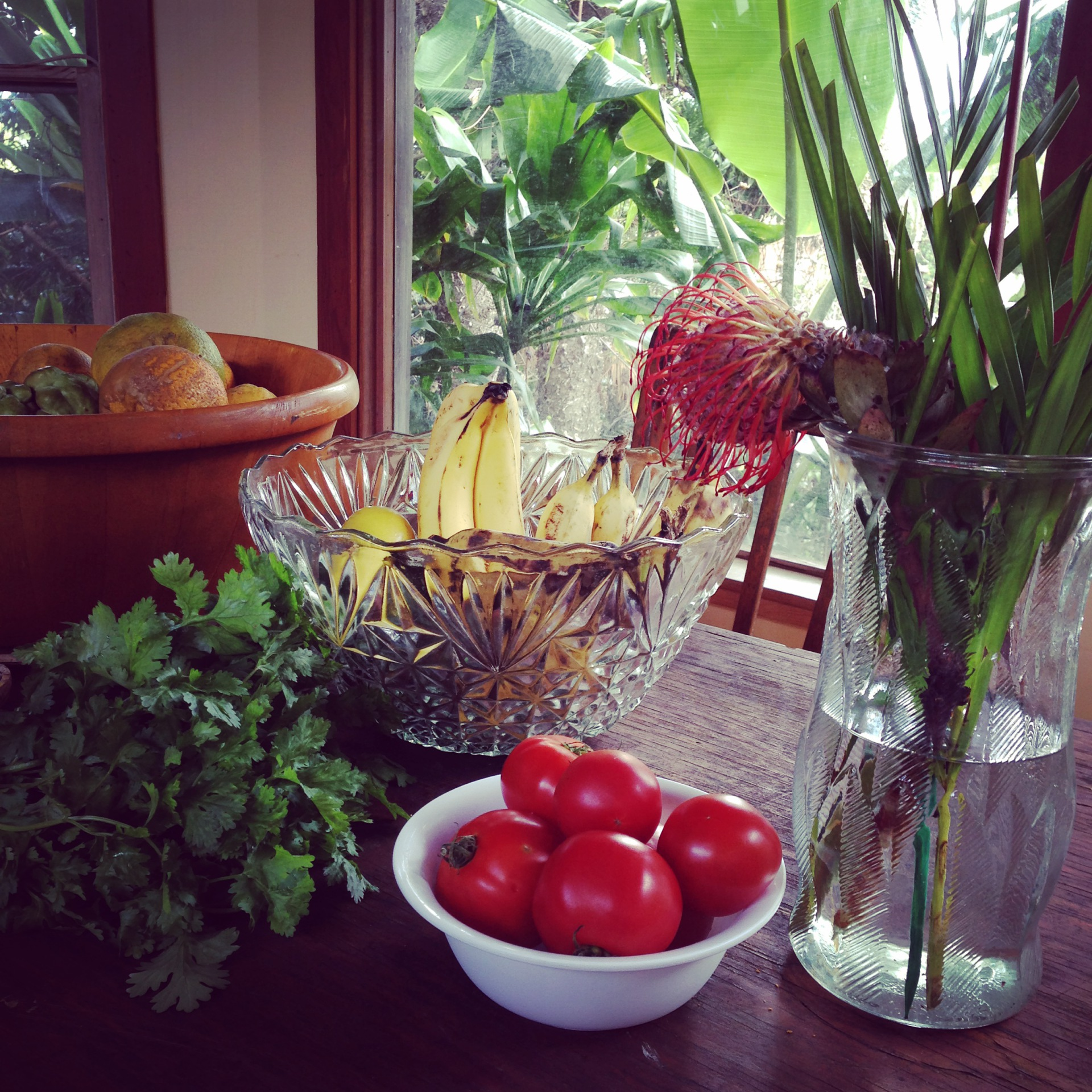 Fresh fruit, herbs and flowers from the Mark arranged on my dining table after a jaunt to the Market
